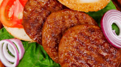 Large roast hamburger with loaf on wood Stock Footage