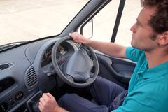 van driver right hand drive vehicle. - stock photo