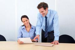 business colleagues woman smiling at camera - stock photo