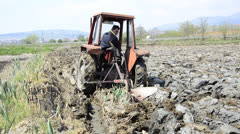 Tractor working in the field Stock Footage