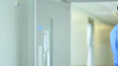 Medical Staff Talking Senior Female Hospital Patient Stock Footage