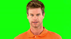 Handsome man saying yes with his head on green screen Stock Footage