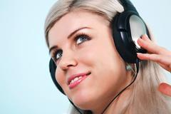 woman wearing headphones listening to music - stock photo