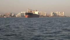 cargo ship on the background of the city - stock footage