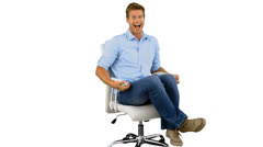 Smiling man turning on swivel chair on white background Stock Footage