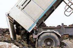 Dump truck dumping Stock Photos