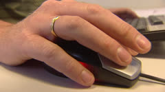Office worker: male hands click mouse and types on computer keyboard Stock Footage