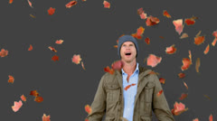 Amazed man looking at falling leaves on grey screen Stock Footage