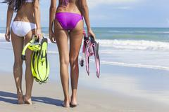 rear view beautiful bikini women at beach - stock photo
