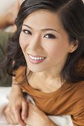 beautiful chinese oriental asian woman smiling - stock photo