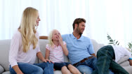 Family giving mother a pink present Stock Footage