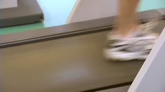 Running feet on treadmill - training Stock Footage
