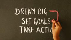 Stock Video Footage of Dream Big, Set Goals, Take Action chalk drawing