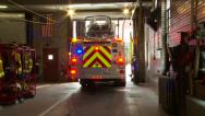Stock Video Footage of Fire Truck Backs Up Into Sation