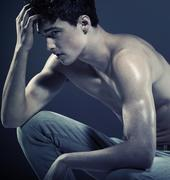 handsome young guy with muscular body - stock photo