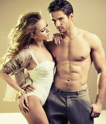 lucky young lady with perfect male body - stock photo