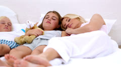 Parents dozing with their children Stock Footage