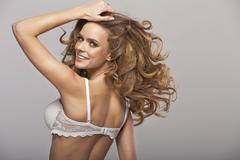fantastic young beauty wearing only bra - stock photo