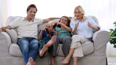 Happy family playing video games at home Stock Footage