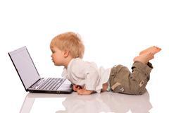 Young boy looking at a laptop Stock Photos