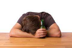 Man sleeping on a table with beer Stock Photos