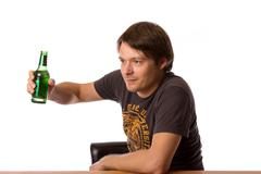 Man with a bottle of beer Stock Photos