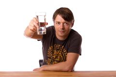 Man with a glass of water Stock Photos