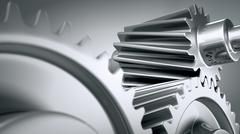 Close up of spinning steel silver chrome cogs gears pinions or engine parts. - stock illustration