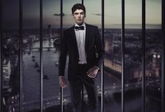 Serious young man on the top of the building Stock Photos