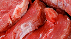 Red meat on wooden table Stock Footage