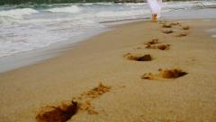 Footsteps Made in Sand by Man in White Religious Concept Background HD - stock footage