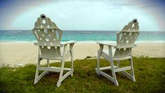 Dolly shot of two rustic chairs at the beach shoreline - stock footage
