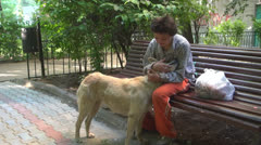 Homeless poor woman and her dog vagabond. Stock Footage