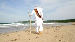 Arab Man Walking on Beach HD Stock Footage