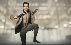 Happy attractive man in jump pose Stock Photos