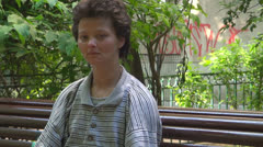Homeless. Sad, homeless poor woman, disoriented.Sad eyes, tears. - stock footage