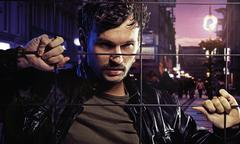 Handsome man in city's jail Stock Photos