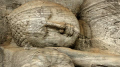 Ancient statue of lying buddha carved out of rock Stock Footage