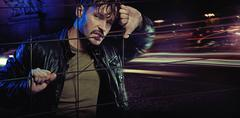 angry look of handsome man wearing leather jacket - stock photo