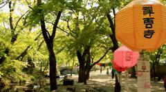 Yellow paper lotus lantern outside temple - stock footage