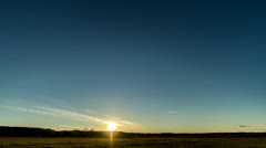 Sunset over the field with a barn. Stars appear. Time Lapse. 4K Stock Footage