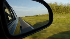 Car Side Mirror. Driving on the freeway. Stock Footage