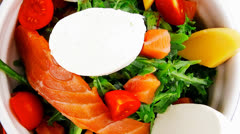 Salad with smoked salmon in bowl Stock Footage