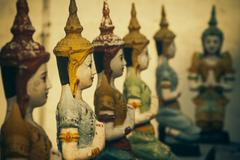 Row of seated buddhas at the temple of wat chomphu in chiang mai, thailand. s Stock Photos