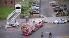 Parking fire truck escorted by police - stock footage