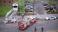 Stock Video Footage of Parking fire truck escorted by police