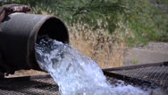 Stock Video Footage of Fresh flowing water from steel pipe.