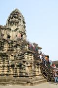 tourists at angkor wat, cambodia - stock photo