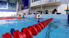 Beautiful view of athlete who is swim backstorke style - stock footage