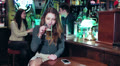 A woman, in a pub, talking on the phone HD Footage